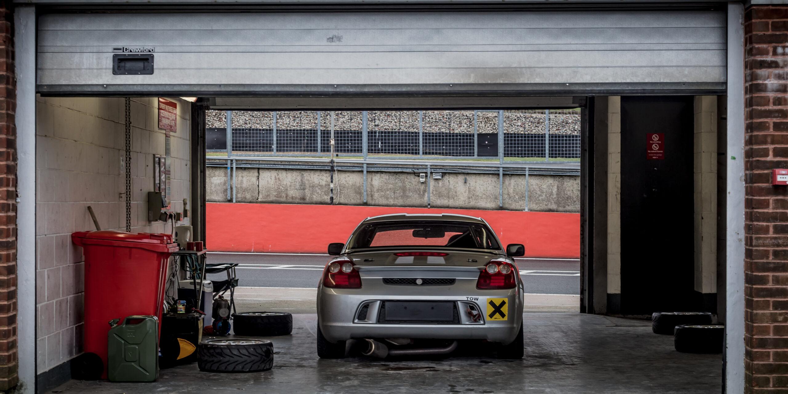 Toyota MR2 sitting in pit garage