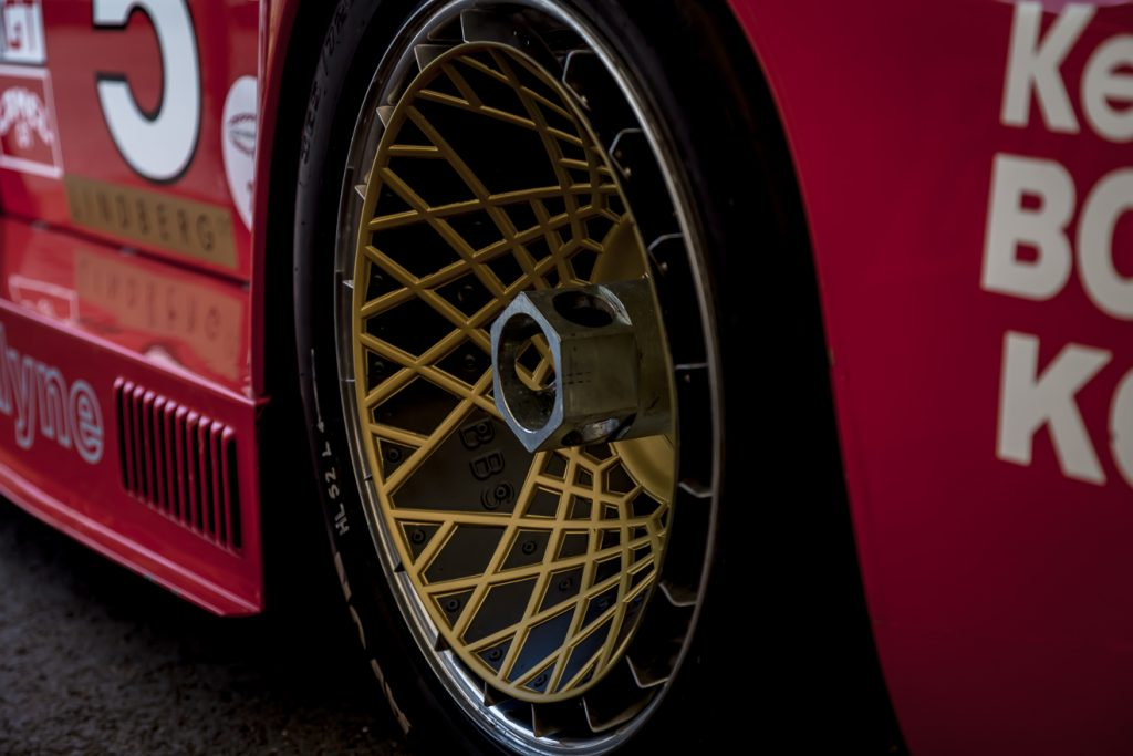 Large wheel nut on red Porsche 935