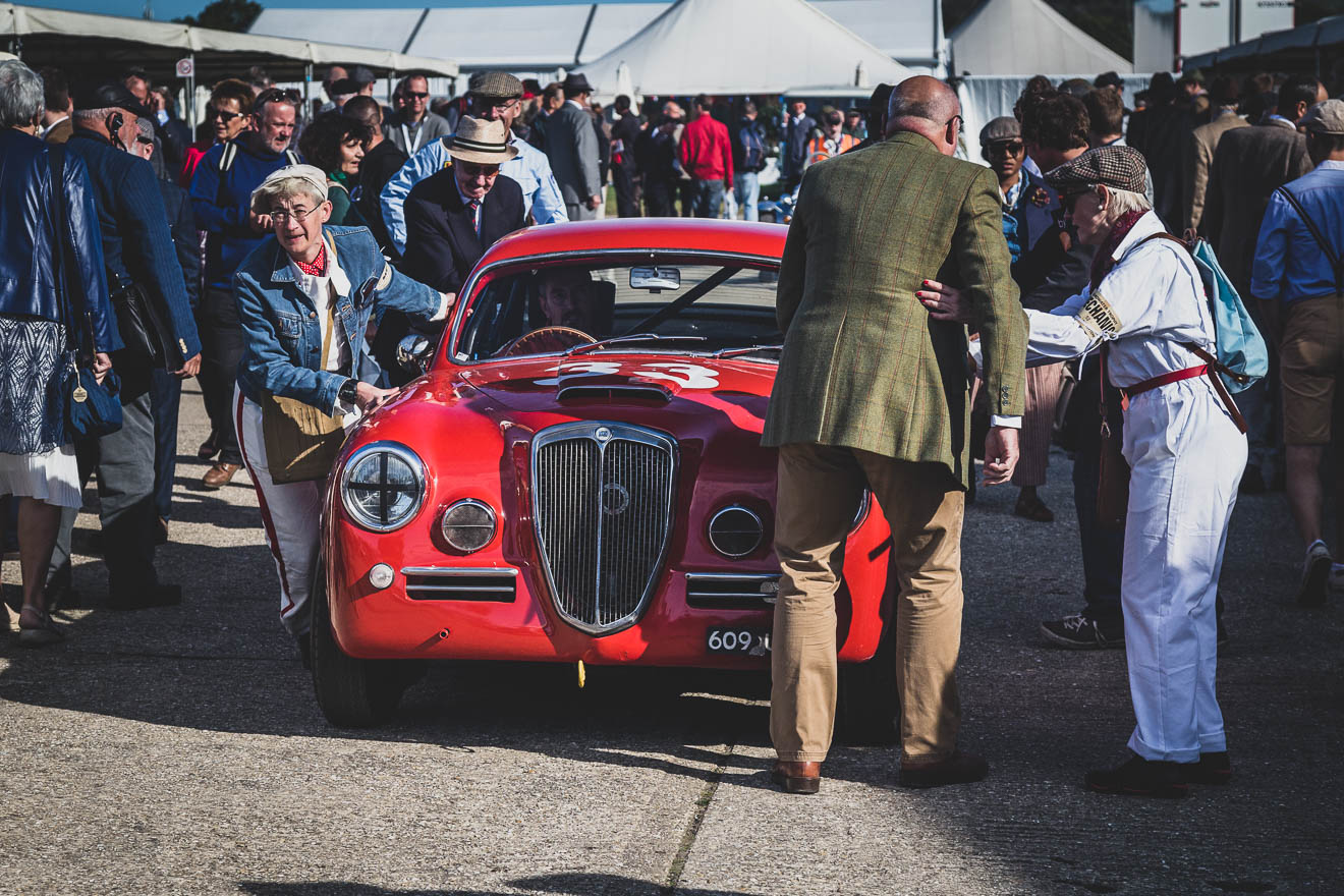 Lancia Aurelia being pushed through the Goodwood Revival pits