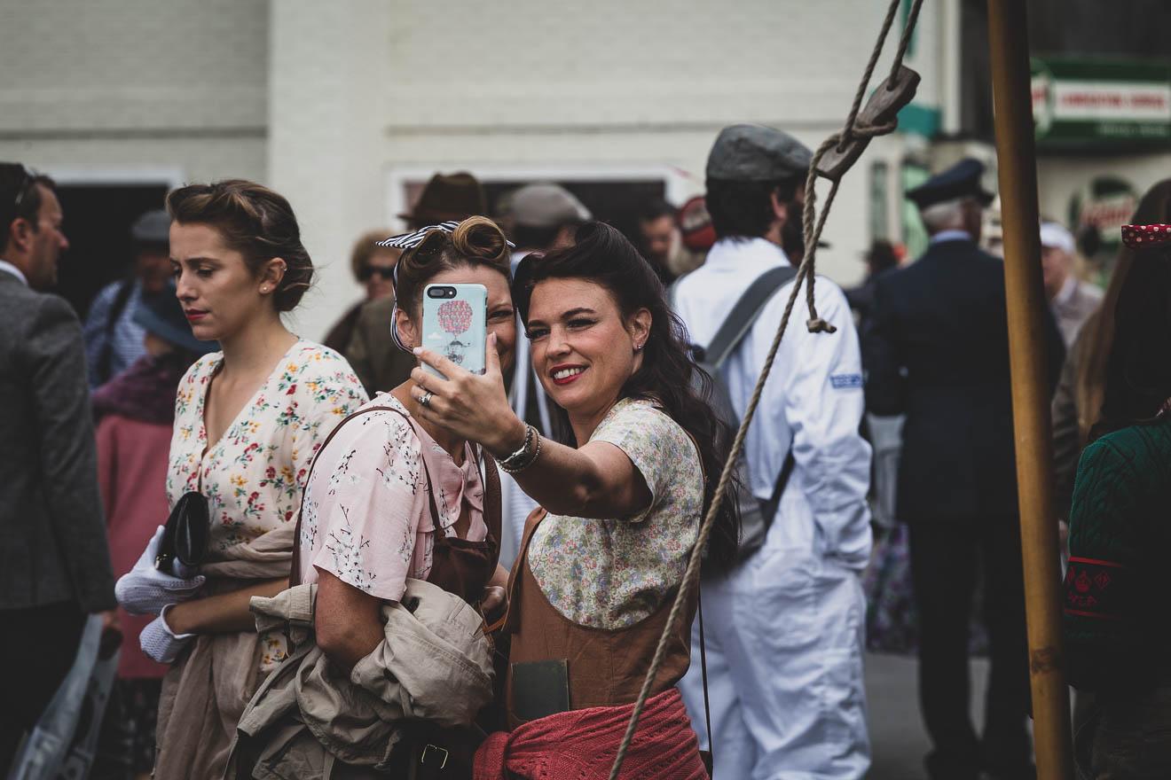 Ladies dressed as land girls at Goodwood Revival