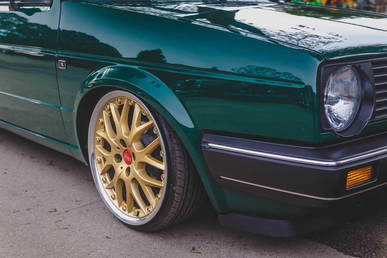 Gold multi-spoke wheels on green mark two Golf