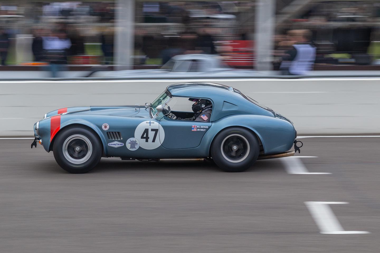 Blue AC Cobra race car at Goodwood 77 Members Meeting