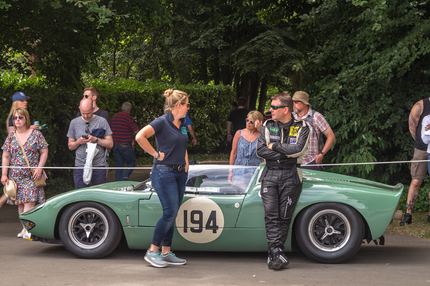 People talking next to Ford GT40