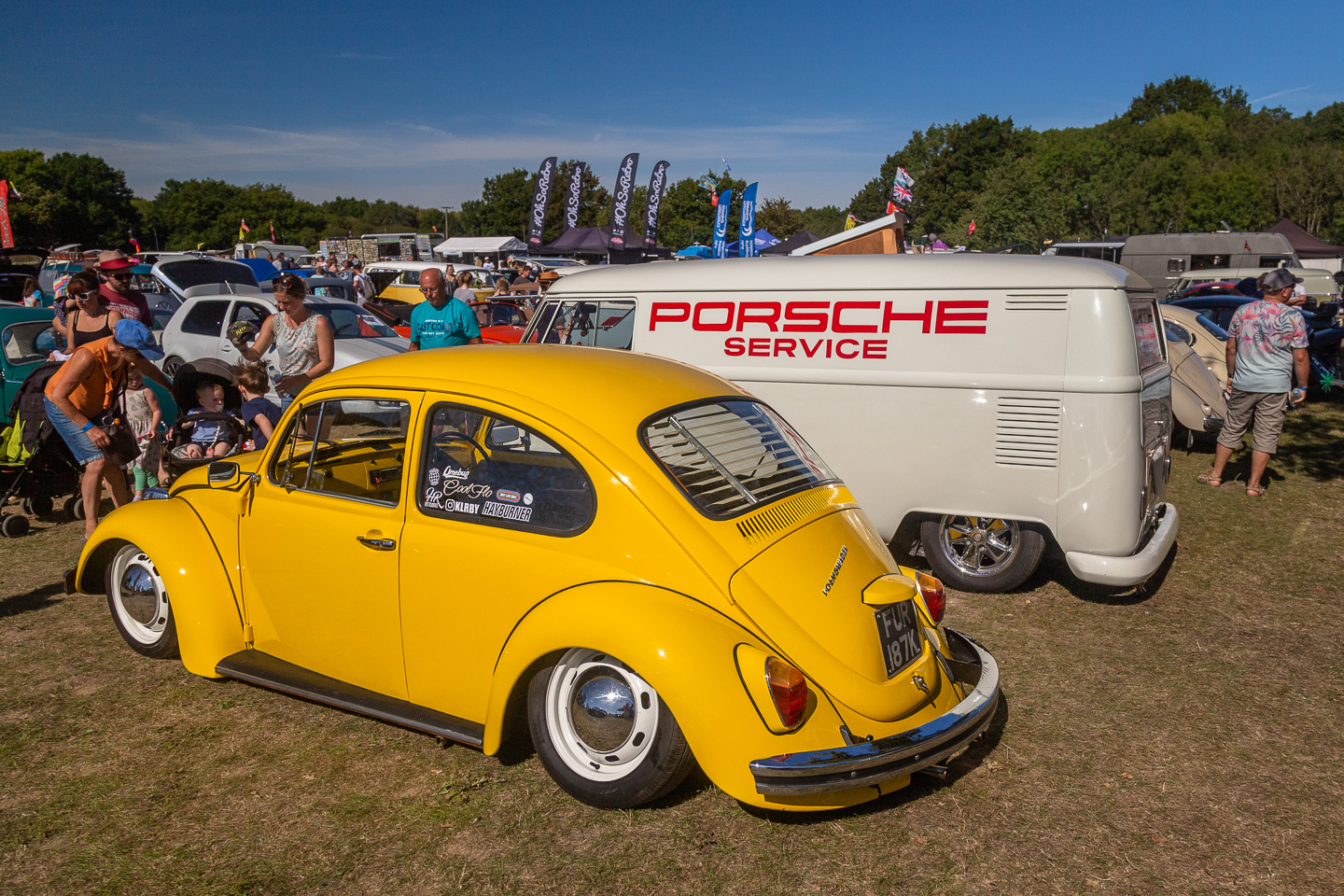 Yellow Volkswagen Beetle and delivery van