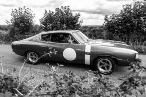 Black and white photograph of a classic muscle car
