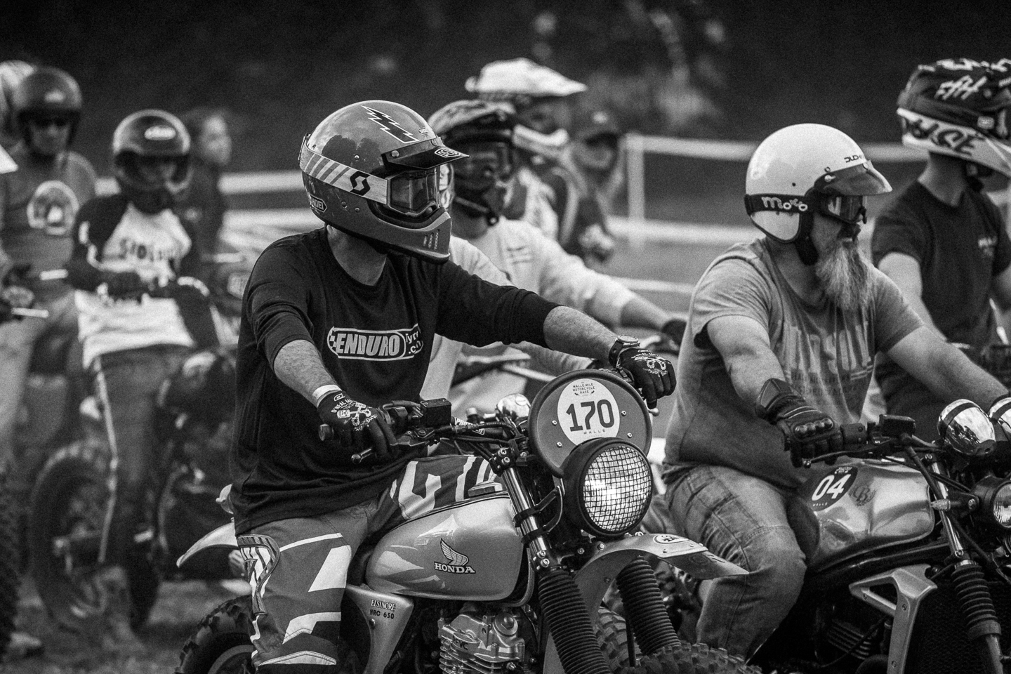 Black and white motorcycle racers waiting