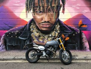 Caballero scrambler deluxe motorcycle in front of graffiti